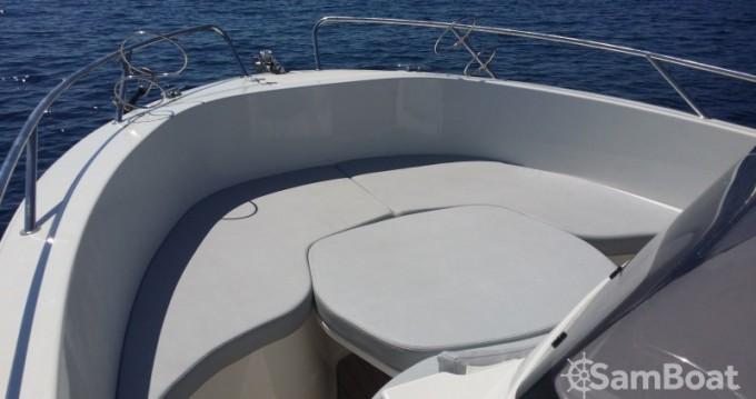Noleggiare una Pacific Craft Open 670 a Golfe de Santa Giulia