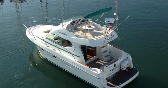 Noleggio barche Jeanneau Prestige 32 a Port de Sitges Aiguadolç su Samboat